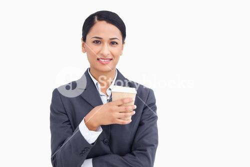 Close up of smiling saleswoman with paper cup