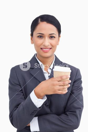 Close up of smiling saleswoman and paper cup