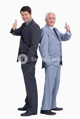 Businessmen standing back-to-back giving thumbs up