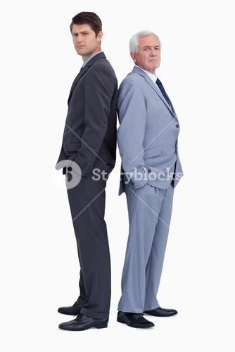 Serious businessmen standing back-to-back