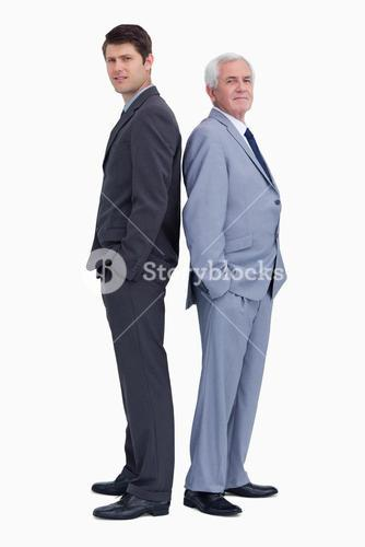 Businessman standing back-to-back with his mentor