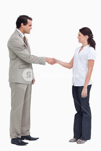 Side view of business people shaking hands