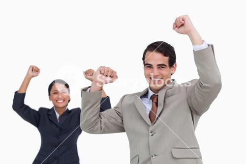 Celebrating salesman with colleague behind him