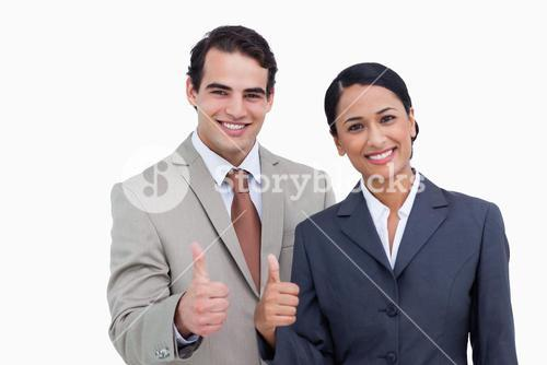 Smiling salesteam giving approval