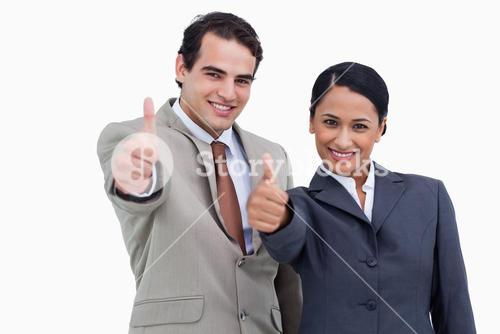 Smiling salespeople giving thumbs up