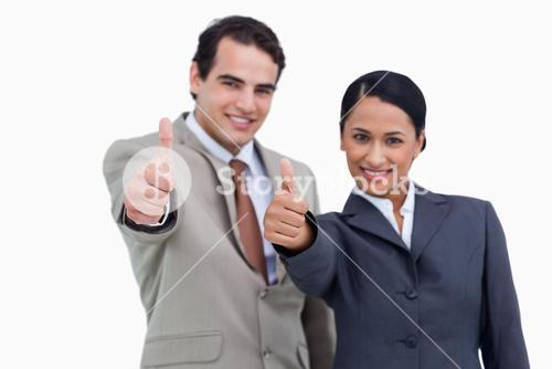 Smiling salesteam giving their approval