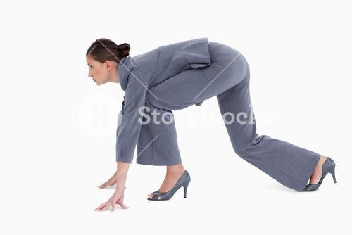 Side view of tradeswoman in sprinting position