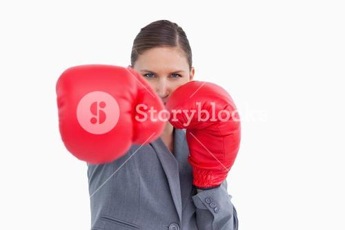 Tradeswoman with boxing gloves attacking