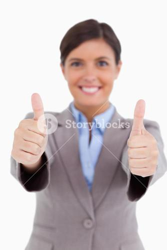 Close up of thumbs up given by female entrepreneur