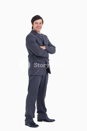 Smiling tradesman with arms folded