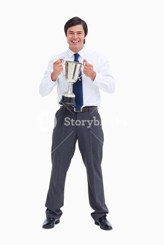 Smiling tradesman holding cup