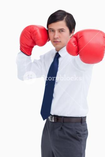 Attacking fist of tradesman in boxing glove