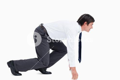 Side view of tradesman in sprinting position