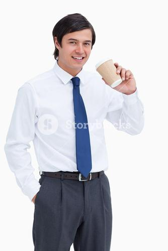 Smiling tradesman with paper cup