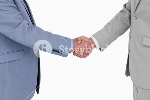 Side view of shaking hands