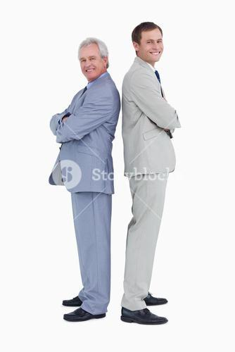 Smiling tradesmen standing back-to-back