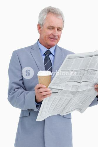 Mature tradesman with news paper and paper cup