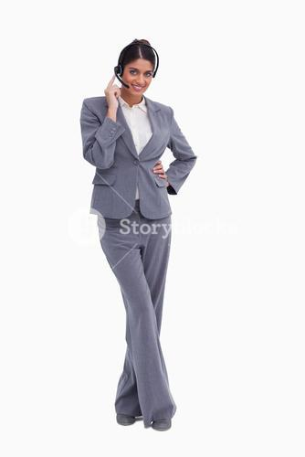 Female call center agent with crossed legs