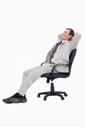 Side view of businessman leaning back in his chair