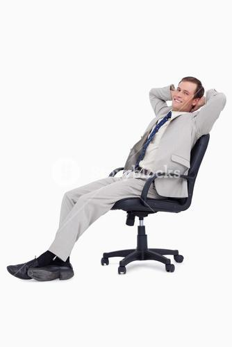 Side view of smiling businessman leaning back in his chair