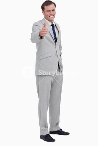Smiling businessman giving his approval