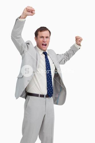 Celebrating businessman with his arms up