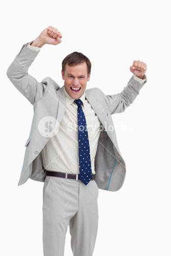 Cheering businessman with his arms up