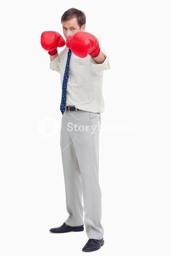 Businessman with boxing gloves in offensive position