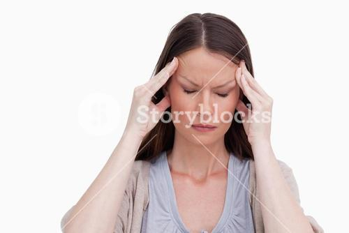 Close up of woman experiencing a headache