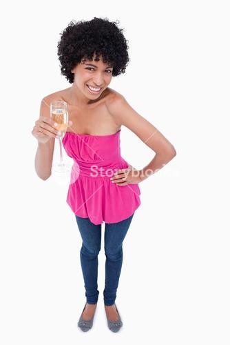Young woman leaning her body forward while drinking white wine