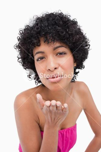 Beautiful shorthaired woman sending a kiss