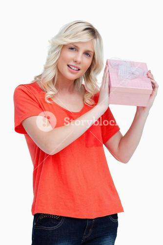 Young woman proudly holding her birthday gift