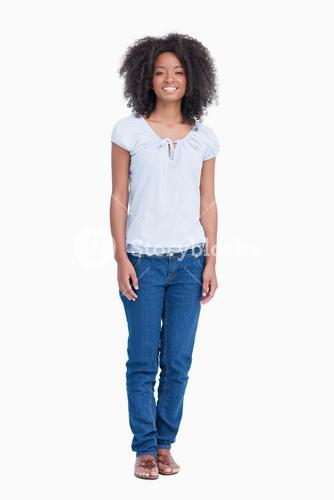 Young woman standing upright while showing a great smile