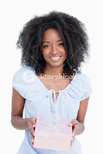 Happy young woman receiving a birthday gift