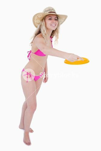Dynamic and attractive teenager playing frisbee