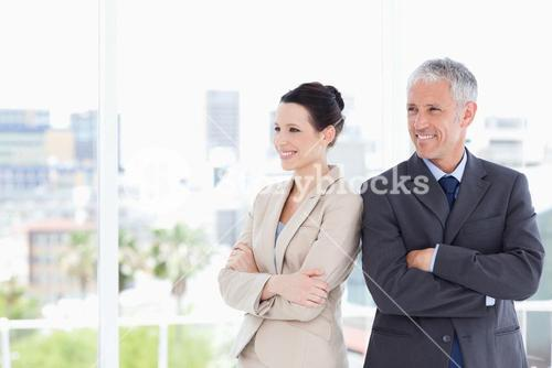 Business people crossing their arms while looking towards the side