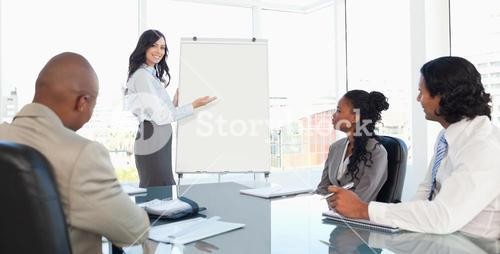 Three earnest employees attentively listening to a presentation