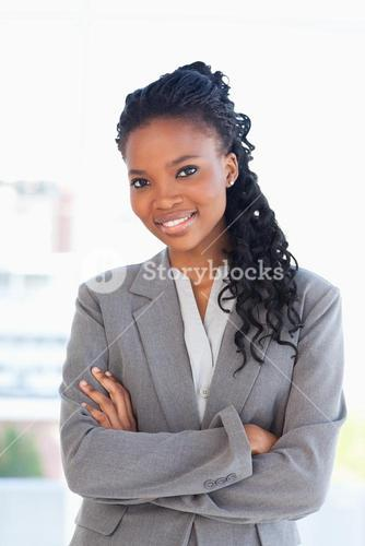 Employee crossing her arms while wearing a formal business suit