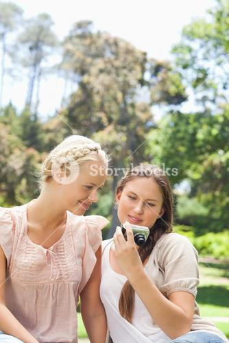 Friends looking at recent photos on their camera