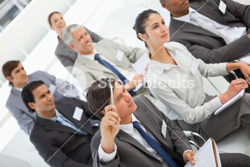 Man asks a question at business meeting