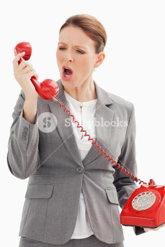 Businesswoman shouts down the phone