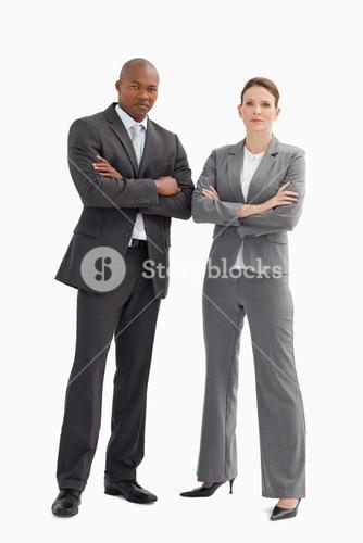 Businessman and a woman with their hands crossed