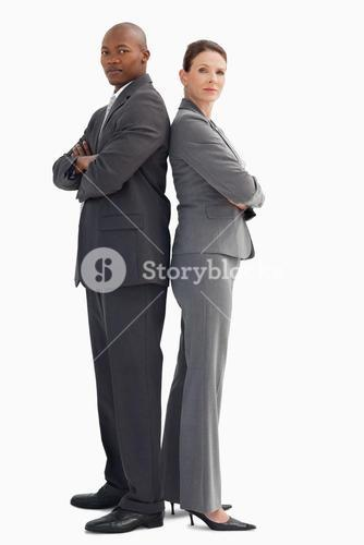 Business man and woman stand back-to-back