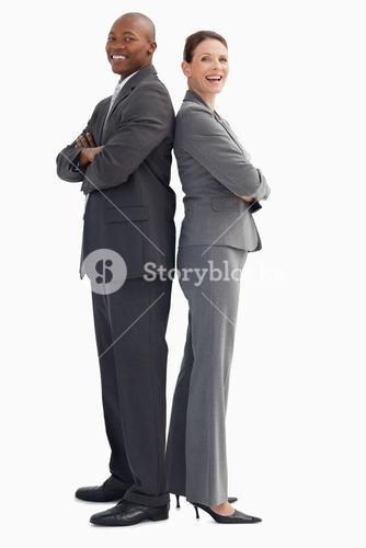 Smiling business people with their hands crossed