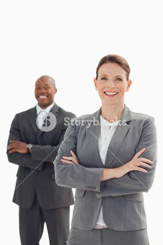 Smiling businesswoman in front of smiling businessman
