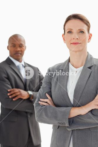 Business people posing with arms crossed