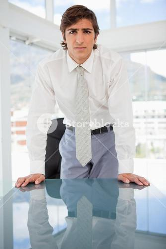Young serious businessman staring at the camera