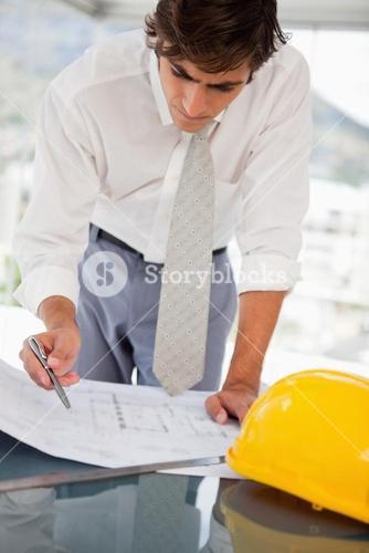 Businessman with blueprints of a building