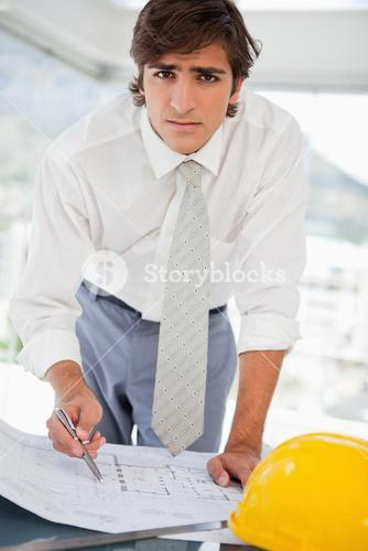 Businessman with construction drawings and a hard hat