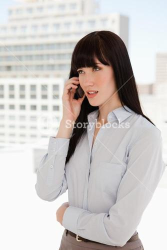 Woman in a suit receiving a phone call